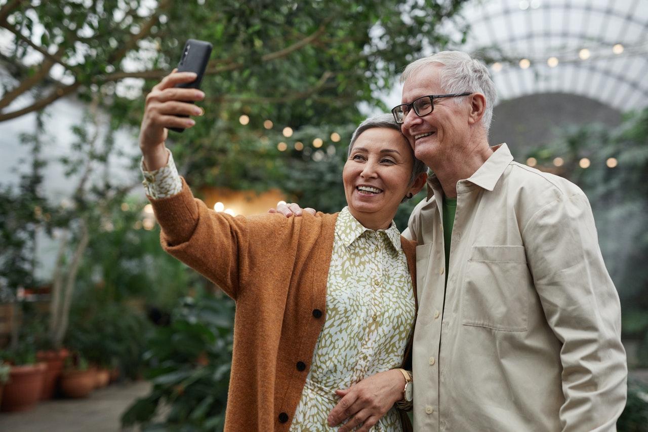 Older Couple Using Smartphone